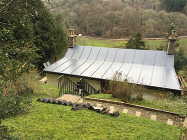Flat roof renovation project for country cottage