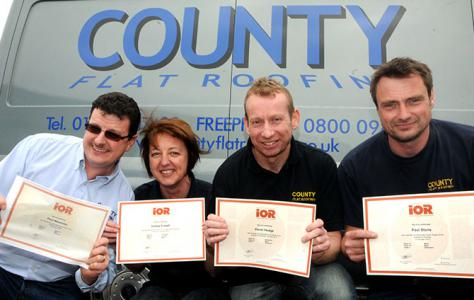 Photo of County Flat Roofing employees holding Institute of Roofing certificates