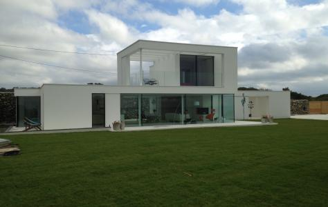 Modern house with Sarnafil flat roof.