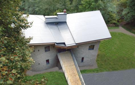 Modern newly build house with Sarnafil single ply membrane installed flat roof.