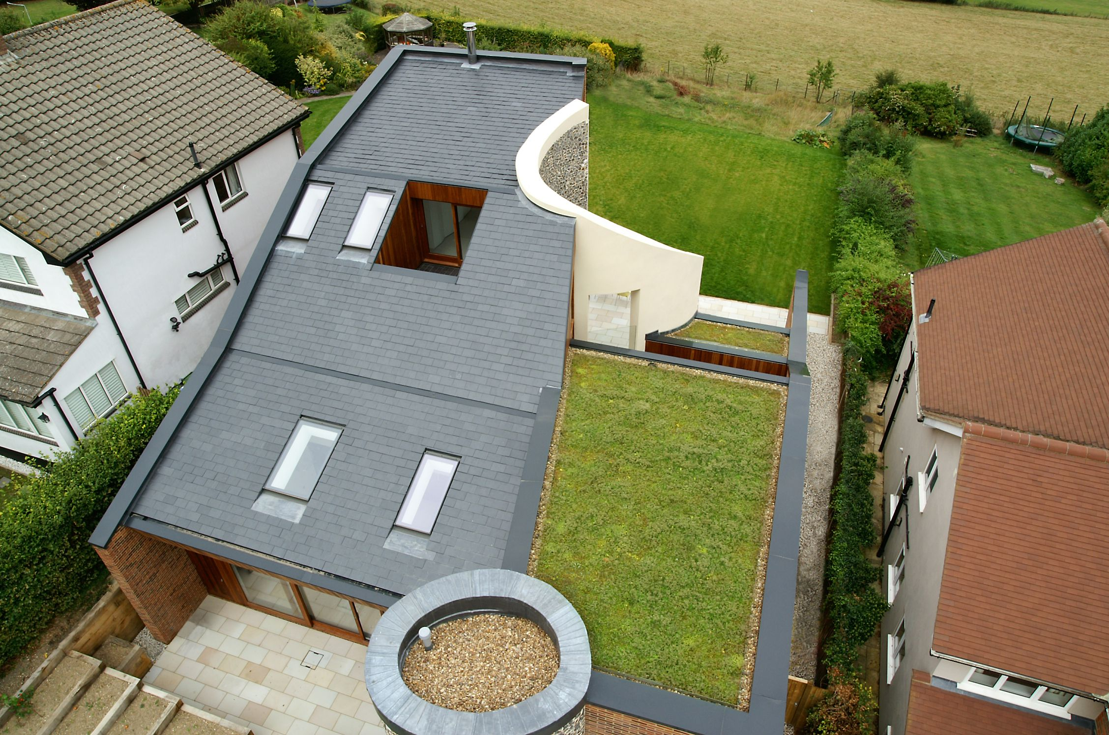 Single ply green roof installations roof assured by sika for Sustainable roofing materials