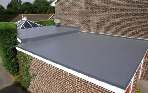 Photo of residential home with new garage roof.