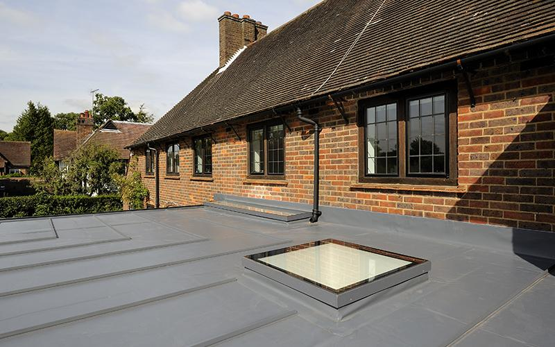 A photo that was taken from on top of a new building extension, focussing on the roof.