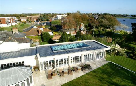 Swimming pool flat roof extension benefits from Sarnafil single ply membrane