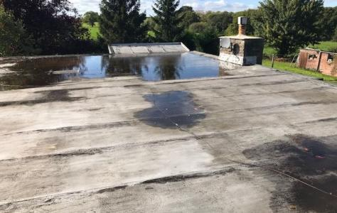 Roof Assured installer replaces leaking asphalt flat roof