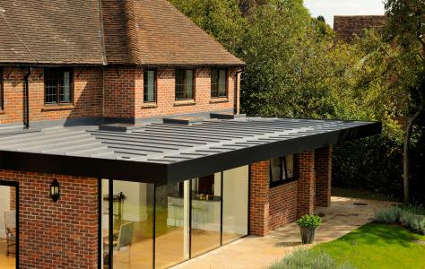 Photo of a house extension with a flat roof.