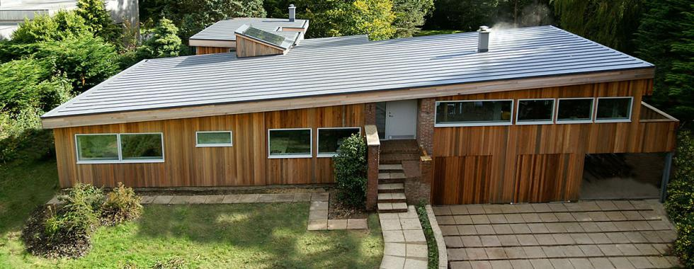 A residential self-build property with flat roof.