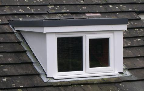 Dormer window built using single ply membrane.