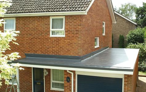 Photo of residential home with new Sarnafil garage roof.
